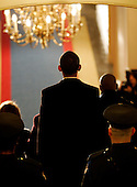 Washington, DC - January 20, 2009 -- United States President-elect Barack Obama walks through the U.S. Capitol crypt behind U.S. Senator Dianne Feinstein (Democrat of California) and  Speaker of the U.S. House of Representatives Nancy Pelosi (Democrat of California) on his way to being sworn in as the 44th President of the United States during the inaugural ceremony in Washington, Tuesday, January 20, 2009..Credit: Molly Riley - Pool via CNP