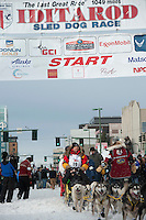 Mitch Seavey and team leave the ceremonial start line with an Iditarider at 4th Avenue and D Street in downtown Anchorage, Alaska on Saturday, March 5th during the 2016 Iditarod race. Photo by Joshua Borough/SchultzPhoto.com