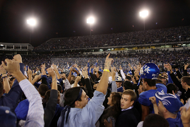 Fans rush the field after UK's comeback 31-28 win over  South Carolina football on Saturday, Oct. 16, 2010. Photo by Britney McIntosh | Staff