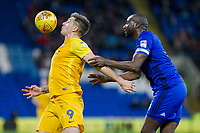 Jordan Hugill of Preston North End controls the ball under pressure from Sol Bamba of Cardiff City during the Sky Bet Championship match between Cardiff City and Preston North End at the Cardiff City Stadium, Cardiff, Wales on 29 December 2017. Photo by Mark  Hawkins / PRiME Media Images.