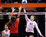 November 22, 2019; Rapid City, SD, USA; Grace Bengford #21 of Sioux Falls O'Gorman tips the ball over Tenley Buddenhagen #4 of Huron at the 2019 South Dakota State Volleyball Championships at the Rushmore Plaza Civic Center in Rapid City, S.D. (Richard Carlson/Inertia)
