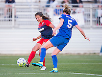 Boyds, MD - April 16, 2016: Boston Breakers defender Kassey Kallman (5) marks Washington Spirit player Katie Stengel  (12). The Washington Spirit defeated the Boston Breakers 1-0 during their National Women's Soccer League (NWSL) match at the Maryland SoccerPlex.