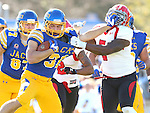 BROOKINGS, SD - OCTOBER 25:  Zach Zenner #31 from South Dakota State University tries to shake the grasp of Desmond Williams #7 from Youngstown State in the first quarter of their game Saturday afternoon at Coughlin Alumni Stadium in Brookings. (Photo by Dave Eggen/Inertia)