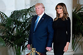 US President Donald J. Trump (L) and First Lady Melania Trump (R) arrive to pay their respects in front of the flag-draped casket of late US Supreme Court Justice John Paul Stevens as he lies in repose in the Great Hall of the Supreme Court, in Washington, DC, USA, 22 July 2019. Stevens, who served on the Supreme Court for nearly thirty-five years, died at age ninety-nine, 16 July.<br /> Credit: Michael Reynolds / Pool via CNP