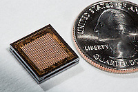 The ion Electrospray Propulsion System (iEPS) for CubeSats is made by MIT's Space Propulsion Lab in Cambridge, Massachusetts, USA. The device, shown here next to a US quarter for scale, is used to maneuver a 10cm cubic satellite in space. The Space Propulsion Lab is directed by Dr. Paulo Lozano, professor in MIT's Department of Aeronautics and Astronautics. Two Ph.D. candidates working on the project, Natalya Brikner and Louis Perna have formed a company, Accion Systems Incorporated, to commercialize the research. Brikner, graduating in Winter 2014, is CEO of the company, and Perna is co-founder.