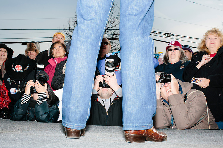 From left, photographers Keiko Hiromi, Nate Gowdy, and Jon Hill, take pictures as Texas senator and Republican presidential candidate Ted Cruz speaks at a Second Amendment Rally outside Granite State Indoor Range in Hudson, New Hampshire.