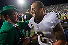 Sept. 14, 2013; Cornerback Bennett Jackson (2) celebrates with the Leprechaun.<br /> <br /> Photo by Matt Cashore