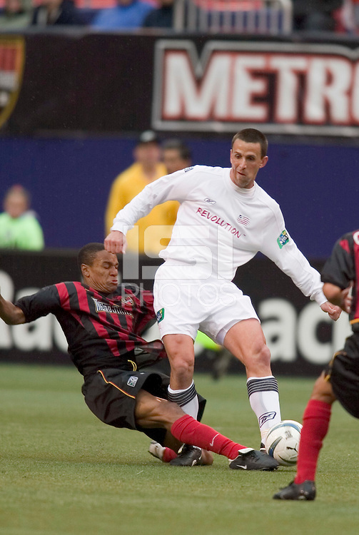 The MetroStars' Ricardo Clark tackles the ball away from New England Revolution's Brian Kamler. The New England Revolution played the NY/NJ MetroStars to a 1 to 1 tie at Giant's Stadium, East Rutherford, NJ, on April 25, 2004.
