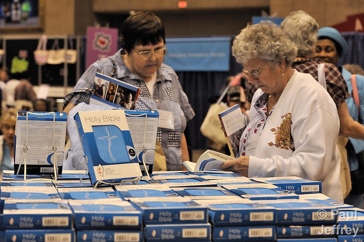 Women check out a special United Methodist Women edition of the Bible in the Experience Hall at the 2010 Assembly of United Methodist Women in St. Louis, Missouri, Missouri.