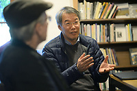 NWA Democrat-Gazette/ANDY SHUPE<br />Zang Di, a poet from China, speaks Saturday, Oct. 12, 2019, during a poetry workshop at Nightbird Books in Fayetteville that is part of a tour meant to unite U.S. and Chinese poets.