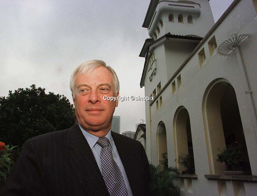 180697: PATTEN HONG KONG<br /> <br /> The Last Governor of Hong Kong, Chris Patten poses outside Government house after an interview with the LA times in hong Kong.