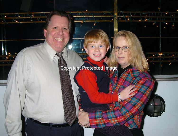 Cole Kachelhoffer, who  plays Parker, with parents Doug and Debbie..at The As The World Turns Christmas Party on      December 5, 2003 at Club New York in New York City. Photo by Robin Platzer, Twin Images