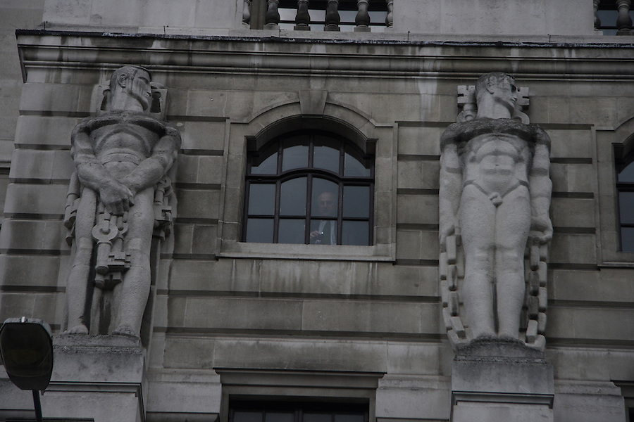 A banker inside the Bank of England looks down upon the G20 Demonstration.
