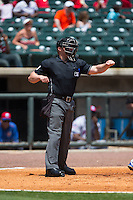 Home plate umpire Garrett Patterson makes a strike call during the Southern League game between the Tennessee Smokies and the Birmingham Barons at Regions Field on May 4, 2015 in Birmingham, Alabama.  The Barons defeated the Smokies 4-3 in 13 innings. (Brian Westerholt/Four Seam Images)