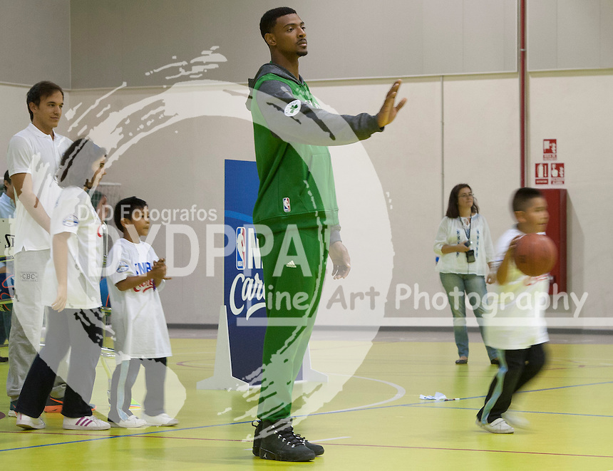 Jordan Mickey during clinic with kids