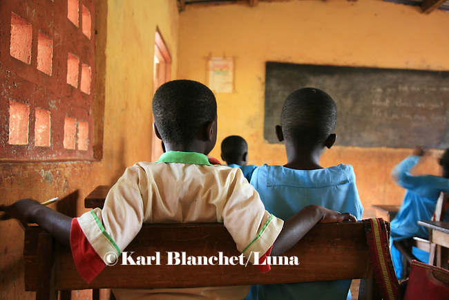 Two boys from the Islamic school in Sunyani, Ghana, listening to the teacher. In Ghana, coranic schools were transformed into islamic schools. Pupils learn the mainstream curriculum and have additional courses in arabic and islam.