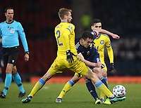 19th November 2019; Hampden Park, Glasgow, Scotland; European Championships 2020 Qualifier, Scotland versus Kazakhstan; John McGinn of Scotland plays the ball forward while Sergei Maliy of Kazakhstan puts in a tackle - Editorial Use