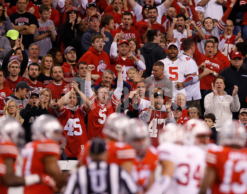 Ohio State fans cheer on the Buckeyes during the first quarter of the Big Ten Championship game against the Wisconsin Badgers at Lucas Oil Stadium in Indianapolis on Dec. 6, 2014. (Adam Cairns / The Columbus Dispatch)