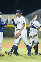 Nic Wilson (44) of the Princeton Rays high fives teammates following their win over the Burlington Royals at Burlington Athletic Park on July 9, 2014 in Burlington, North Carolina.  The Rays defeated the Royals 3-0.  (Brian Westerholt/Four Seam Images)