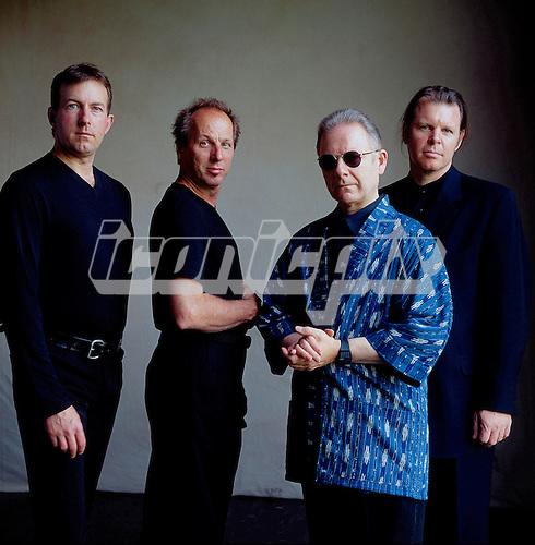 KING CRIMSON - L-R: Trey Gunn, Adrian Belew, Robert Fripp, Pat Mastelotto - photosession in London UK - 2000.  Photo credit: GEMA/IconicPix