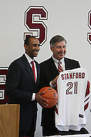 STANFORD, CA - APRIL 28:  Stanford Cardinal men's basketball head coach Johnny Dawkins (L) is introduced by director of athletics Bob Bowlsby (R) during a press conference on April 28, 2008 at Kissick Auditorium in Stanford, California.