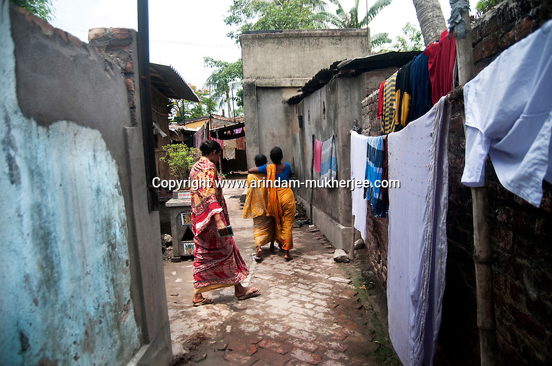 For sustainability Bandhan gives emphasis in relationship building. Women going back home after paying their weekly instalment in Canning, West Bengal, India. Arindam Mukherjee