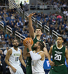 Colorado State's Nico Carvacho, top, blocks the shot of  Nevada's Cody Martin in the second half of an NCAA college basketball game in Reno, Nev., Sunday, Feb. 25, 2018. (AP Photo/Tom R. Smedes)