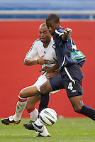 D.C. United's Earnie Stewart battles the New England Revolution's Avery John for the ball. The New England Revolution and D.C. United finished in a scoreless tie in MLS play at Gillette Stadium, Foxboro, MA on Saturday August 28, 2004.
