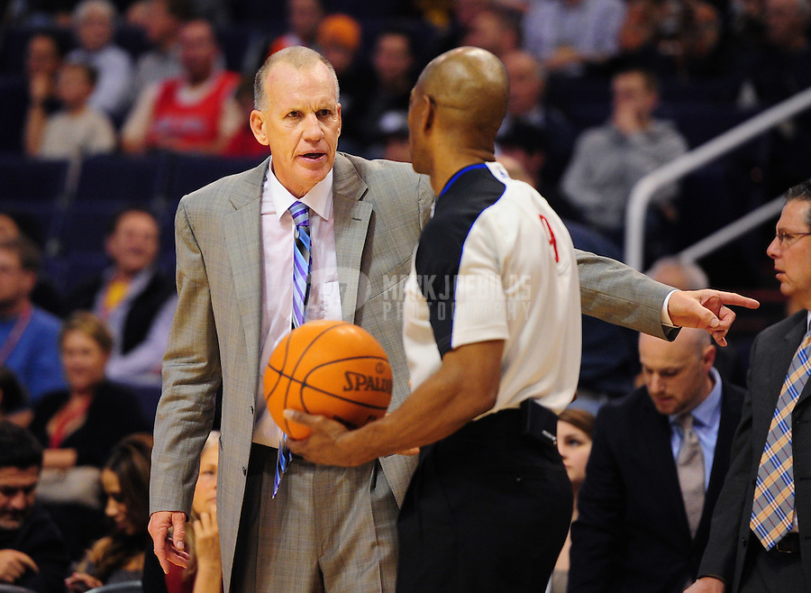 Dec. 28, 2011; Phoenix, AZ, USA; Philadelphia 76ers head coach Doug Collins (left) talks with NBA referee Tom Washington during game against the Phoenix Suns at the US Airways Center. The 76ers defeated the Suns 103-83. Mandatory Credit: Mark J. Rebilas-USA TODAY Sports