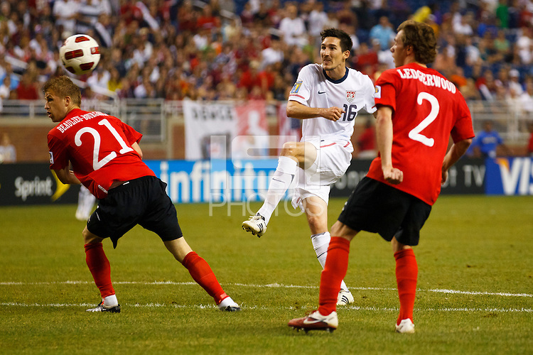 7 June 2011: USA Men's National Team midfielder Sacha Kljestan (16) takes a shot as Canada midfielder Jonathan Beaulieu-Bourgault (21) and midfielder Nikolas Ledgerwood (2) defend during the CONCACAF soccer match between USA MNT and Canada MNT at Ford Field Detroit, Michigan. USA won 2-0.