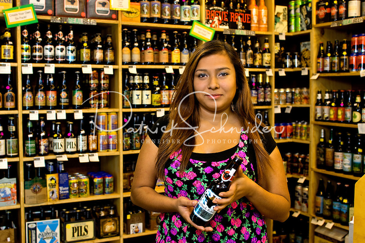 Salud Beer Shop is a vendor at 7th Street Public Market in Uptown Charlotte, North Carolina. Building upon the success of Charlotte's Center City Green Market, the Seventh Street Public Market opened in 2012 to be a year-round market serving and celebrating local food artisans, entrepreneurs and local and regional farmers. Image is part of a series of photos taken of the Center City attraction.