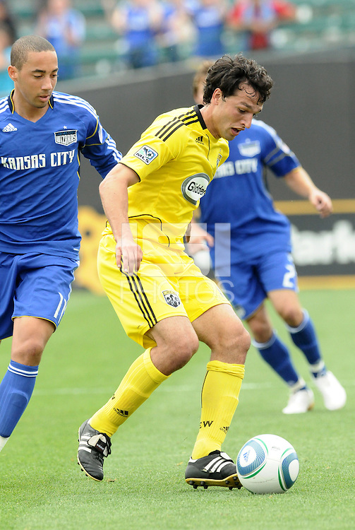 Jed Zayner (yellow).Ryan Smith...Kansas City Wizards were defeated 1-0 by Columbus Crew at Community America Ballpark, Kansas City, Kansas.