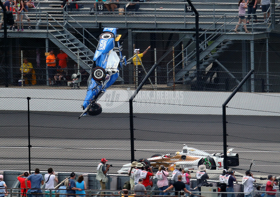May 28, 2017; Indianapolis, IN, USA; IndyCar Series driver Scott Dixon (9) goes airborne and crashes in front of Helio Castroneves (3) during the 101st Running of the Indianapolis 500 at Indianapolis Motor Speedway. Mandatory Credit: Mark J. Rebilas-USA TODAY Sports