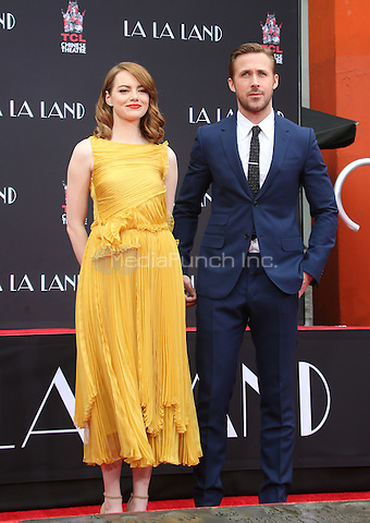 Hollywood, CA - DECEMBER 07: Emma Stone, Ryan Gosling, At Ryan Gosling And Emma Stone Hand And Footprint Ceremony At TCL Chinese Theatre IMAX, California on December 07, 2016. Credit: Faye Sadou/MediaPunch