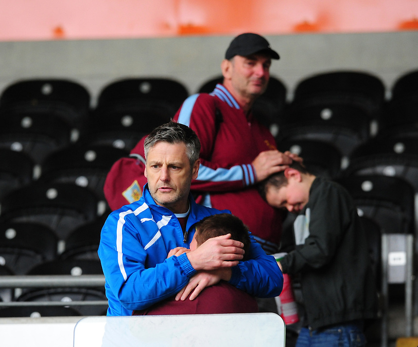 Two young Burnley fans are consoled after relegation from the Premier League had been confirmed, despite a 1-0 over Hull City<br /> <br /> Photographer: Chris Vaughan/CameraSport<br /> <br /> Football - Barclays Premiership - Hull City v Burnley - Saturday 9th May 2015 - Kingston Communications Stadium - Hull<br /> <br /> &copy; CameraSport - 43 Linden Ave. Countesthorpe. Leicester. England. LE8 5PG - Tel: +44 (0) 116 277 4147 - admin@camerasport.com - www.camerasport.com