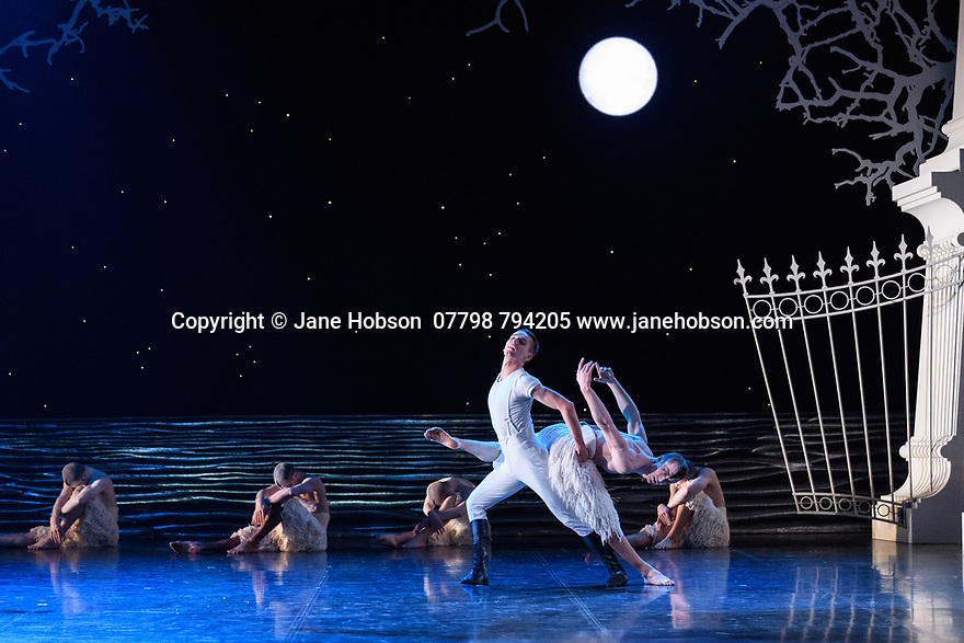 "London, UK. 07.12.2018. Matthew Bourne's ""Swan Lake"" returns to Sadler's Wells Theatre, for a run until Sunday 27th January 2019. Choreographed by Matthew Bourne, with lighting design by Paule Constable and costume design by Lez Brotherston. Dancer are: Matthew Ball (The Swan), Liam Mower (The Prince), Nicole Kabera (The Queen), Katrina Lyndon (The Girlfriend), Glenn Graham (The Private Secretary), Megan Cameron (The Hungarian Princess), Freya Field (The German Princess), Zanna Cornelis (The Romanian Princess), Nicole Alphonse, Jonathan Luke Baker, Tom Broderick, Kayla Collymore, Keenan Flethcer, Bryony Harrison, Parsifal James Hurst, Jack Mitchell, Harry Ondak-Wright, Ashley-Jordan Packer, Jack William Parry, Stan West, Carrie Willis. Picture shows: Liam Mower (The Prince), Matthew Ball (The Swan). Photograph © Jane Hobson."