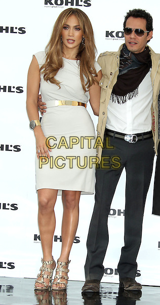 JENNIFER LOPEZ & MARC ANTHONY .Jennifer Lopez And Marc Anthony Announce New Partnership With Kohl's held at The London Hotel, Los Angeles, CA, USA, 18th November 2010..full length dress white gold belt beige jacket married couple husband wife grey gray trousers cuff bracelet scarf arm around snakeskin sandals snake .CAP/ADM/BP.©Byron Purvis/AdMedia/Capital Pictures.
