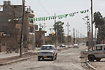 Vehicles move through the streets of the front line Christian town of Hamdaniya in Iraq.