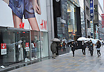 """March 23, 2011, Tokyo, Japan - """"Store Closed"""" a notice posted on the front door of H&M in Tokyo's Ginza shopping district on Wednesday, March 23, 2011. Stores, shops, boutiques and restaurants in Ginza have voluntarily close as Japan's largest electric utility company began the first-ever rolling blackout from March 14 to help prevent an unexpected large-scale power outage after a powerful earthquake shut two nuclear plants indefinitely on March 11. The blackout, however, could sharply curtail Japan's economic growth and disrupt global commerce. (Photo by Natsuki Sakai/AFLO) [3615] -mis-"""