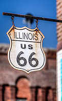 Old wood Route 66 sign in Atlanta Illinois.