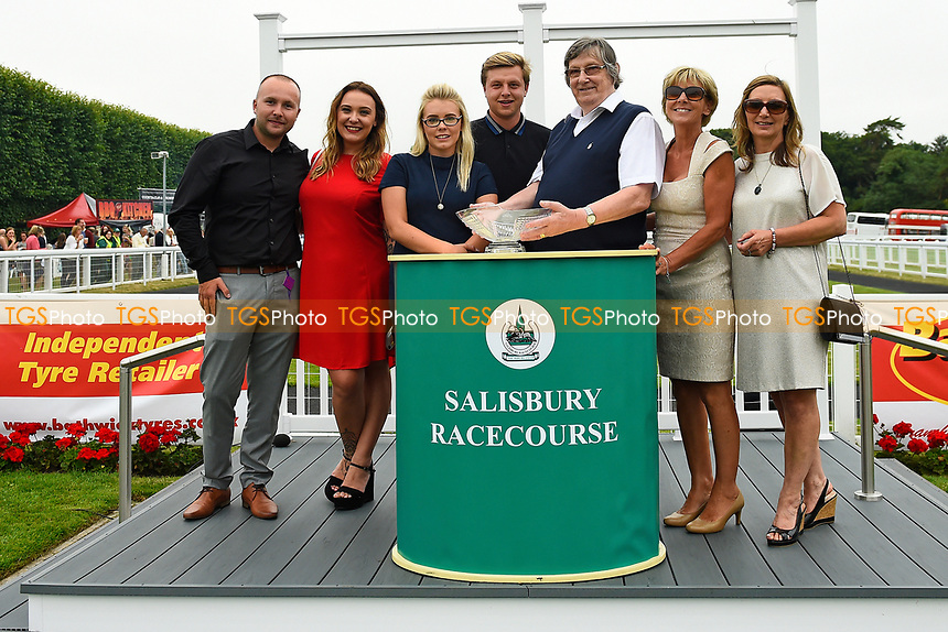 Connections of Dandy Flame receive their trophy from sponsor Tony Brown after winning  The Tony Brown's 75th Birthday Handicap during Ladies Evening Racing at Salisbury Racecourse on 15th July 2017