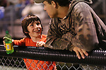 Wyatt Gay, 10, talks with his older brother Tanner Horton while watching a football game at Leslie County High School in downtown Hyden, Ky., on Thursday, October 10, 2013. Photo by Emily Wuetcher