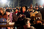 """A crowd of eager people await Punxsutawney Phil at Gobbler's Knob in Punxsutawney, Pennsylvania before dawn February 2, 2012. The groundhog is said to speak """"groundhogese"""" to one member of the """"inner circle"""" (men in top hats) to predict an early spring or a long winter each year."""