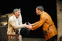 London, UK. 18.07.2014. Mountview Academy of Theatre Arts presents SATURDAY, SUNDAY, MONDAY by Eduardo de Filippo, the English adaptation by Keith Waterhouse & Willis Hall, directed by Michael Howcroft, at the Unicorn Theatre, as part of the Postgraduate Season 2014. Picture shows:  Mark Desmond (Antonio) and Pete Grimwood (Federico). . Photograph © Jane Hobson.