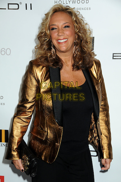 DENISE RICH .EMI Post Grammy Party 2010 held at the W Hollywood Hotel, Hollywood, California, USA, 31st January 2010..half length gold bronze shiny jacket black clutch bag top grammys .CAP/ADM/BP.©Byron Purvis/Admedia/Capital Pictures