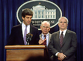Washington, DC - (FILE) -- United States Senator John F. Kerry (Democrat of Massachusetts), left, retired United States Army General John Vessey, former chairman of the Joint Chiefs of Staff, and Special Emissary to Vietnam for P.O.W./M.I.A. affairs, center, and United States Senator John McCain (Republican of Arizona), right, meet reporters in the White House Press Briefing Room after United States President George H.W. Bush announced the Government of Vietnam had agreed to make available all information including photographs, artifacts, and military documents on United States prisoners of war (POWs) and those missing in action (MIAs) in the Rose Garden of the White House on Friday, October 23, 1992. .Credit: Ron Sachs / CNP
