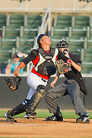 Catcher Miguel Gonzalez #12 of the Kannapolis Intimidators chases after a foul pop fly at Fieldcrest Cannon Stadium August 3, 2010, in Kannapolis, North Carolina.  Photo by Brian Westerholt / Four Seam Images