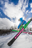 Freestyle skiing on a blue sky day in Michigan.