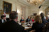 """United States President Barack Obama, third from right, speaks while meeting with members of the Democratic Governors Association in the State Dining Room with Jason Furman, chairman of the Council of Economic Advisers (CEA), from left, U.S. Vice President Joseph """"Joe"""" Biden, from left, Valerie Jarrett, senior advisor to Obama, and Cecilia Munoz, director of the White House Domestic Policy Council, in Washington, D.C., U.S., on Friday, Feb. 21, 2014. Obama will emphasize Democratic priorities in his next budget, dropping an offer to trim the growth of entitlement spending and proposing new tax limits for U.S.-based multi-national companies. <br /> Credit: Andrew Harrer / Pool via CNP"""