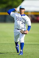 Burlington Royals pitcher Andres Machado (34) warms up in the outfield prior to the game against the Greeneville Astros at Burlington Athletic Park on June 29, 2014 in Burlington, North Carolina.  The Royals defeated the Astros 11-0. (Brian Westerholt/Four Seam Images)